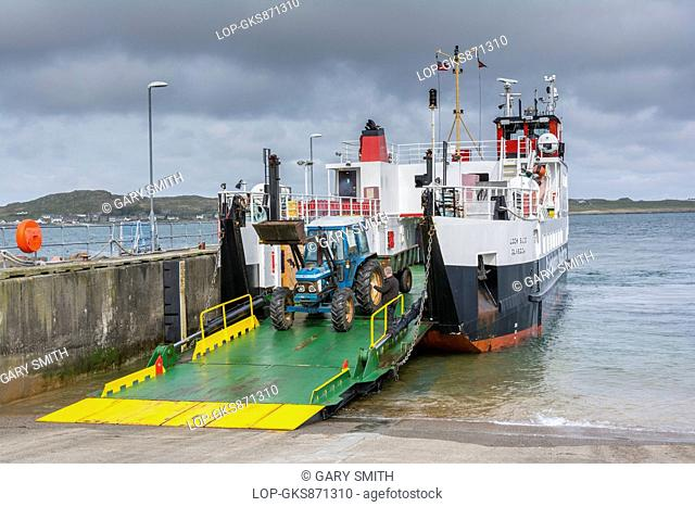 Scotland, Isle of Mull, Fionnphort. A tractor reverses onto the Fionnphort to Iona ferry