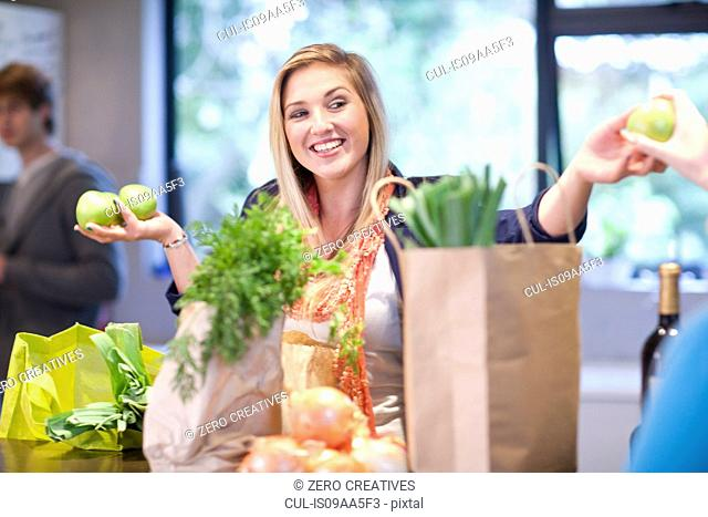 Young woman unpacking groceries