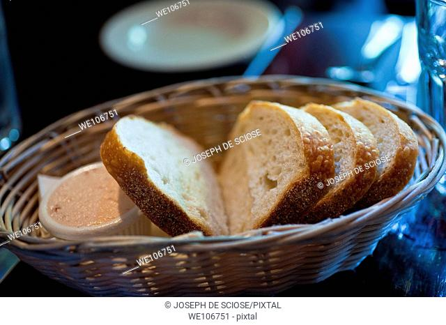 A basket of bread on a restaurant table, New York City, USA