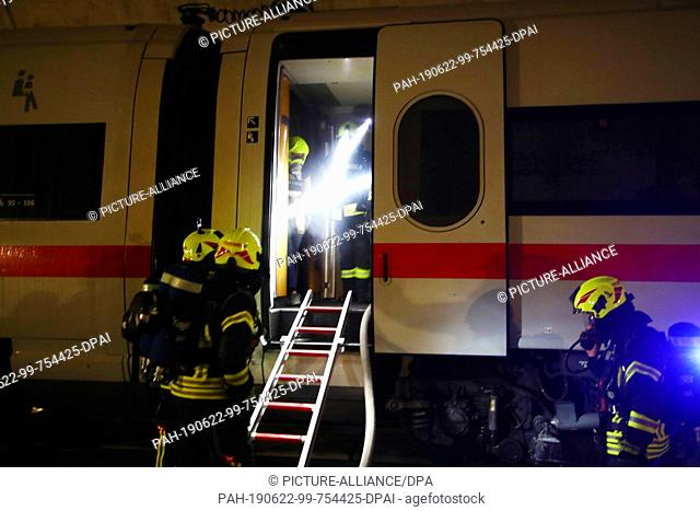 "22 June 2019, Thuringia, Goldisthal: Emergency forces rescue """"injured"""" from an ICE train in the Fleckberg tunnel during an emergency exercise"