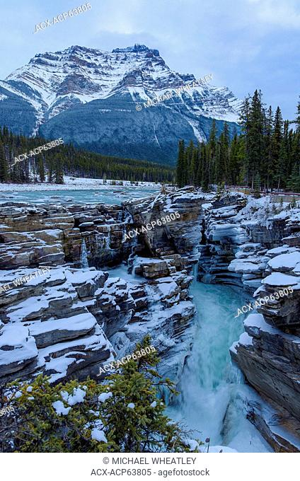 Athabasca Falls in Winter with Mount Kerkeslin, Jasper National Park, Alberta, Canada