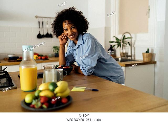 Woman having a healthy breakfast in her kitchen