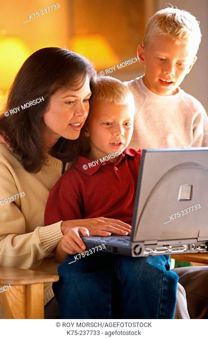 Mom, her two sons, and laptop
