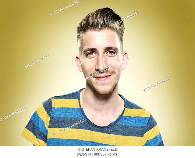 Portrait of smiling young man , studio shot