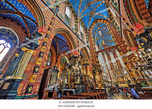 Interior shot with rich decoration of Church of Our Lady Assumed into Heaven or St. Mary's Basilica on market square of Krakow, Poland - Cracow, Poland