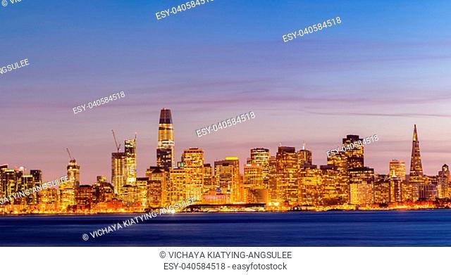 San Francisco downtown skyline at dusk from Treasure Island, California, sunset, USA. Panorama