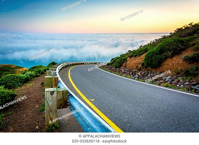 Road and view of fog over the San Francisco Bay, Golden Gate National Recreation Area, in San Francisco, California