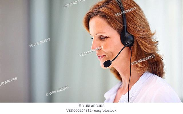 Pretty receptionist taking a call then looking at you