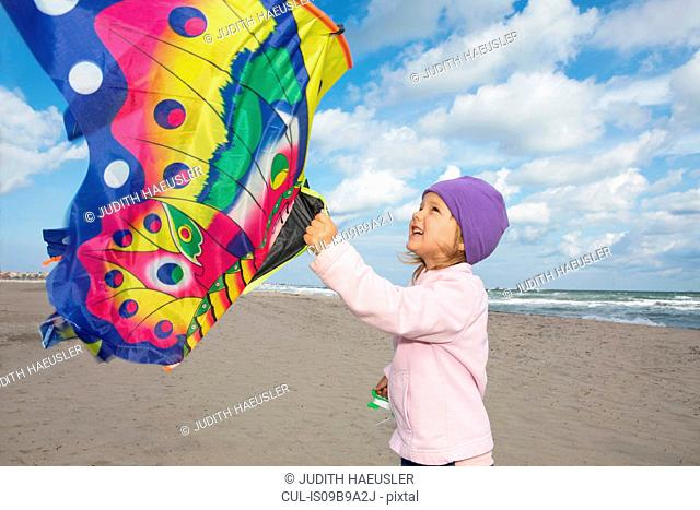 Girl flying kite on beach