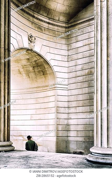 Person walks under the arch of The Bank Of England ,City of London,England