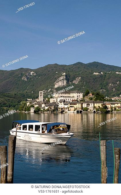 motorboat and San Giulio Island, lake Orta, Piedmont, Italy