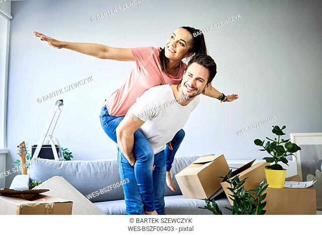 Carefree couple moving into new home