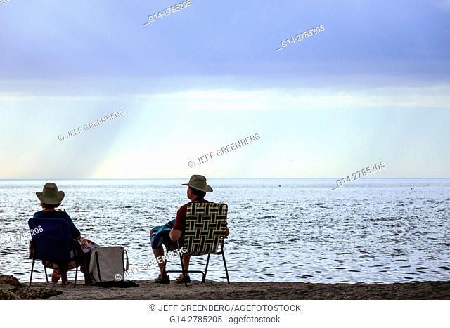 Florida, Captiva Island, Turner Beach, Gulf of Mexico, man, woman, couple, folding chairs, water