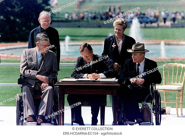 President Bush signs into law the Americans with Disabilities Act of 1990 on the South Lawn of the White House. Washington, D.C. January 20, 1993