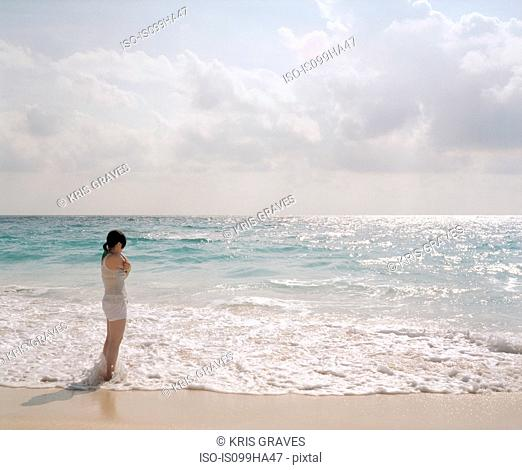 Young woman looking out to sea, Bermuda