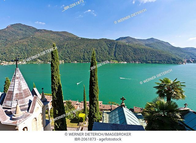 Cemetery in Morcote, Cypress (Cupressus) trees, Lake Lugano, Lago di Lugano, Ticino, Switzerland, Europe