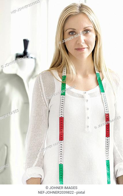 Young woman with tape measure