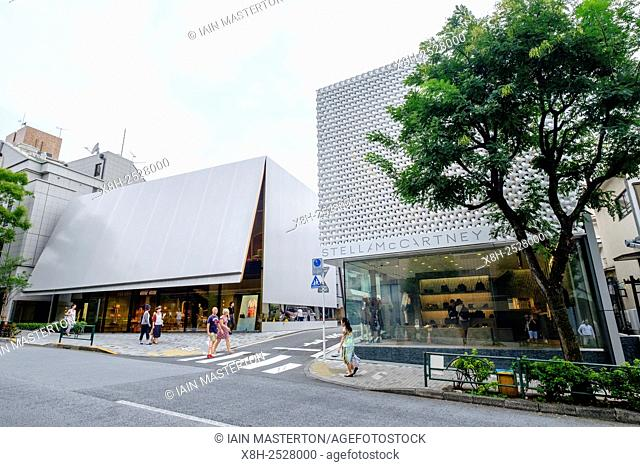 Modern architecture of fashion boutiques Miu Miu and Stella McCartney in upmarket Aoyama district of Tokyo Japan