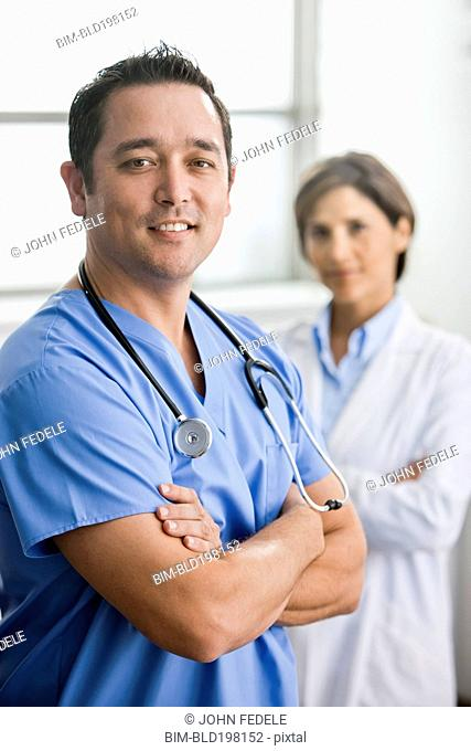 Smiling doctors standing together