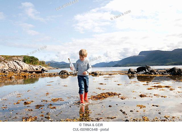 Boy with message in a bottle, Aure, More og Romsdal, Norway