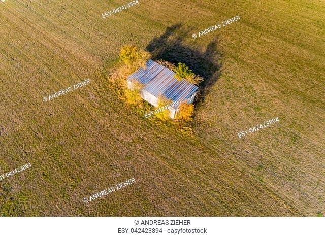 Bird view of a hut in the landscape in autumn
