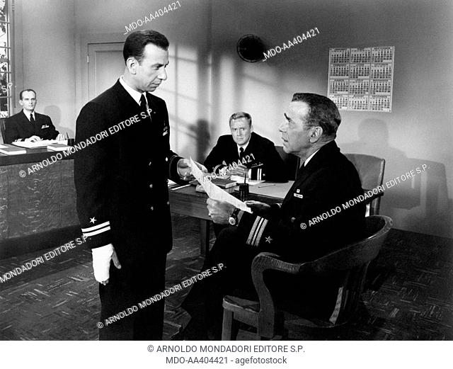 José Ferrer, Humphrey Bogart and Charles Van Johnson in The Caine Mutiny. American actor Humphrey Bogart showing a paper to Puerto Rican-born American actor and...