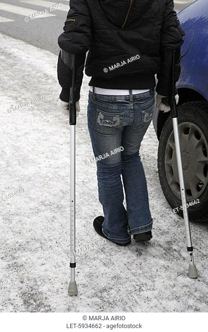 Girl walking on crutches  Espoo, Finland