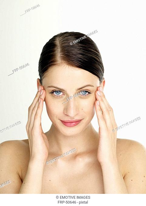 Woman is massaging her face
