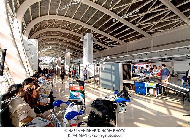 Passengers waiting in checking hall , Chhatrapati Shivaji International Airport , Santacruz , Bombay Mumbai , Maharashtra , India