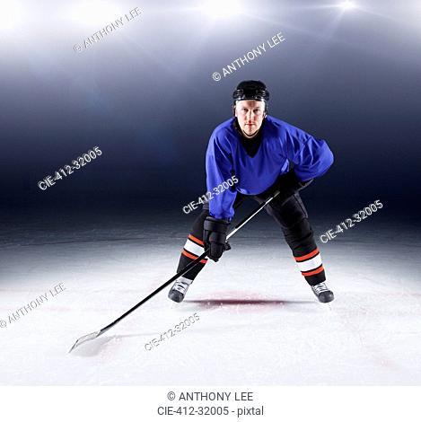 Portrait confident hockey player on ice