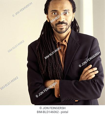 Serious African American businessman with arms crossed