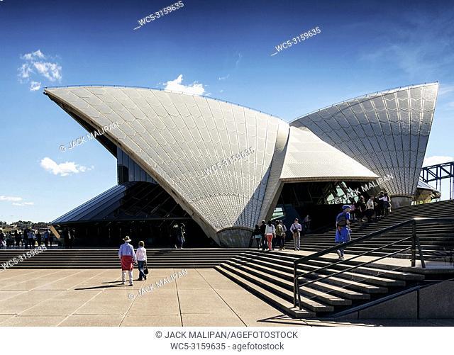 tourists visiting sydney opera house landmark detail in australia on sunny day