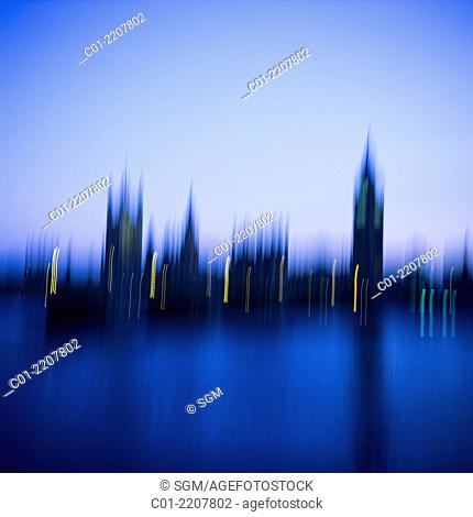 Blurred view of Westminster Palace with Big Ben clock tower at dusk London Great Britain