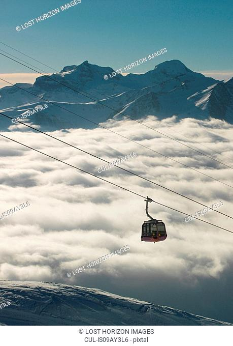 Cable car moving up from mountain fog in the Alps, Bettmeralp, Valais, Switzerland
