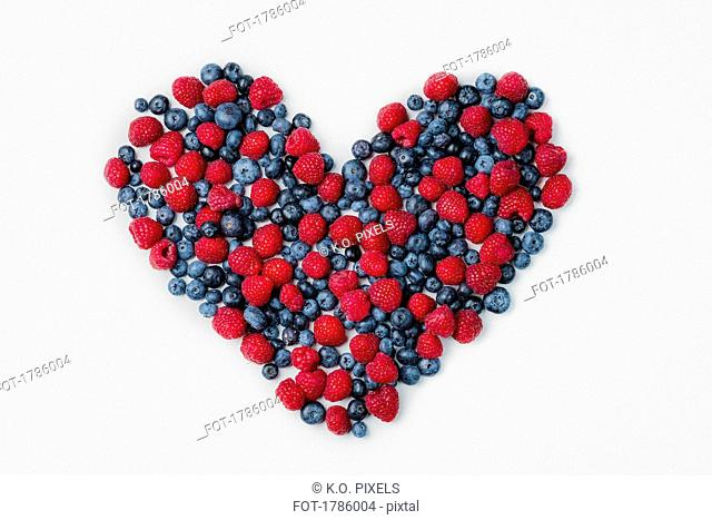 Blueberries and raspberries arranged in heart shape