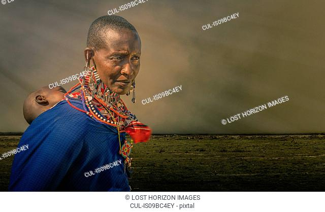 Masai woman with child in a masai village, Amboseli, Rift Valley, Kenya