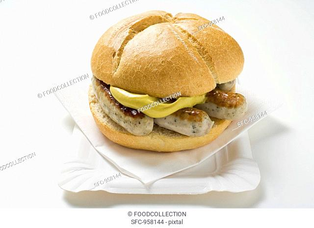 Sausages and mustard in bread roll