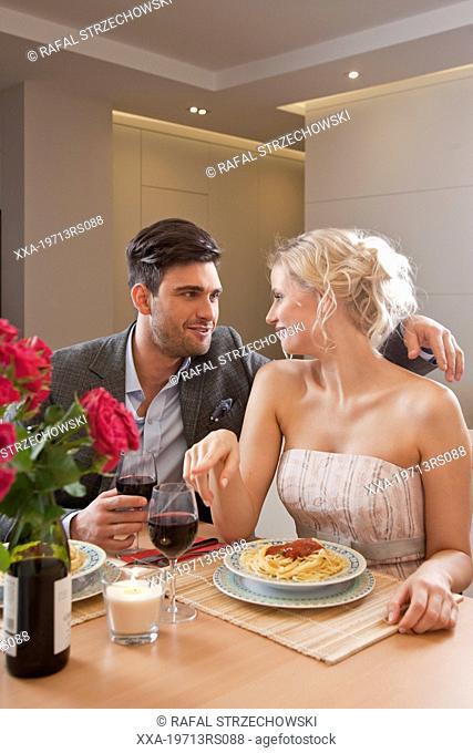 Couple having romantic dinner at home