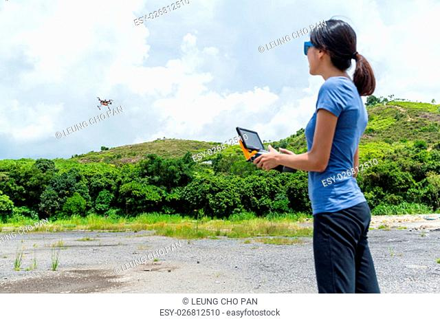Woman play with drone at outdoor