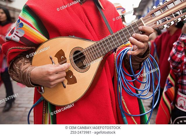 Musician playing mandolin during the celebrations of Inti Raymi Festival at Plaza de Armas, Cuzco, Peru, South America