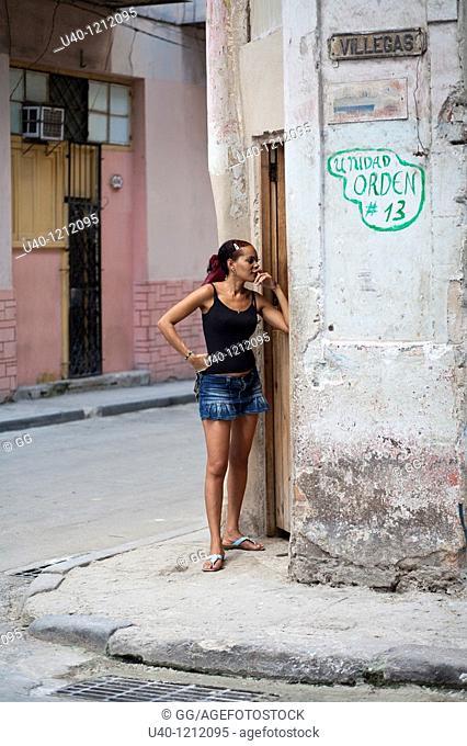 Cuba, Havana Vieja, woman on street corner