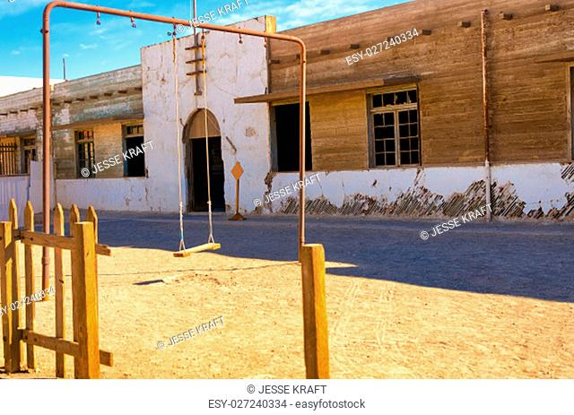 Swingset outside an abandoned school in Humberstone, Chile