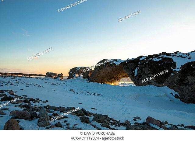 Sunset Through the Arches, Lime Stone rock formation, the Arches Provincial Park, Great Northern Peninsula, Newfoundland and Labrador