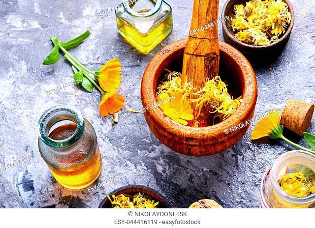 Healing calendula flowers and herbal tincture.Healing plants