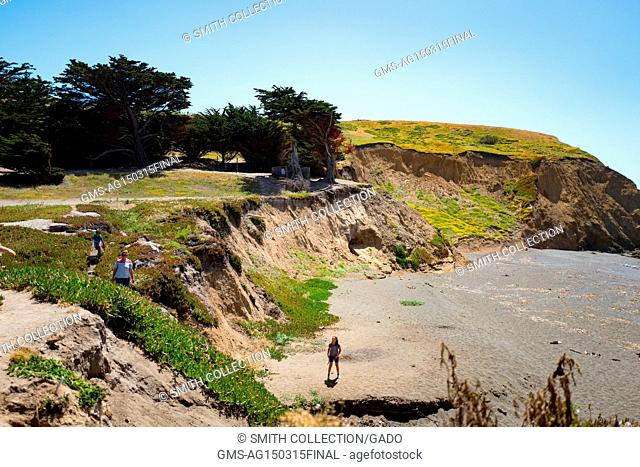A family explores the beach at Mori Point, part of the Golden Gate National Recreation area, in Pacifica, California, June 20, 2017