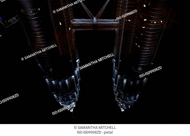 Reflection of Petronas Towers in fountain, Kuala Lumpur, Malaysia