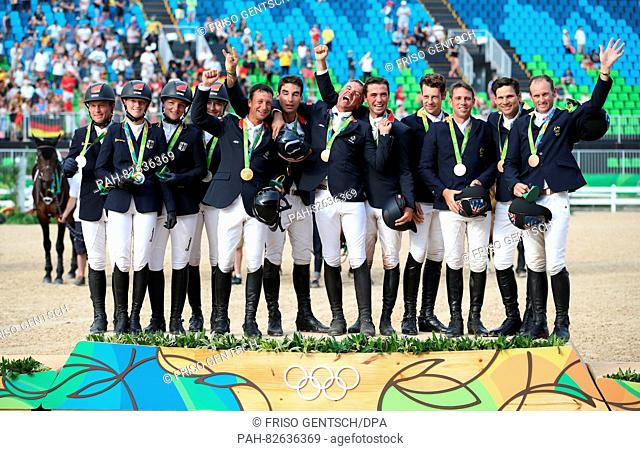 Silver medalists Team Germany (L-R), Gold medalist Team France and Bronze medalist team Australia celebrate on the podium during the medal ceremony after the...