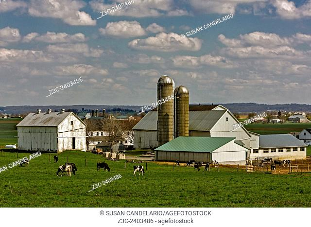 Lancaster Pennsylvania Farms - A view to the many barns, silos and farmland in Amish Country Lancaster, Pennsylvania. A nice afternoon with blue skies and puffy...