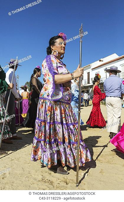 Women wearing beautifully coloured gypsy dresses during the annual Pentecost pilgrimage of El Rocio. Huelva province, Andalusia, Spain