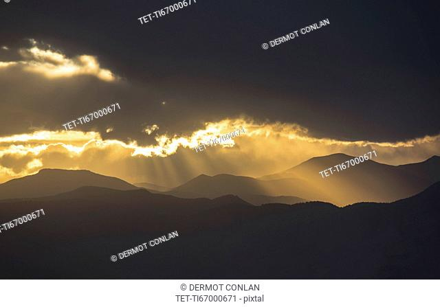 USA, Colorado, Denver, Dramatic sky with sunbeams over mountain range
